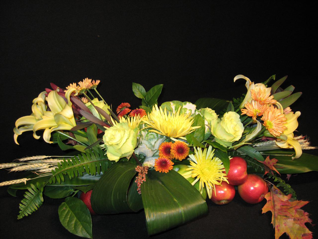 Centerpiece: Ti leaves, kale, apples, roses