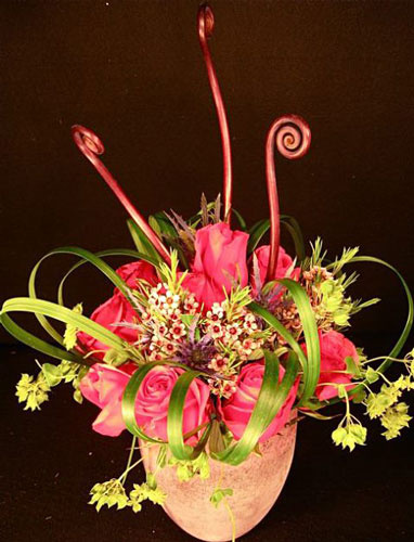 Centerpiece: roses, lilygrass, wax flower, monkeytail