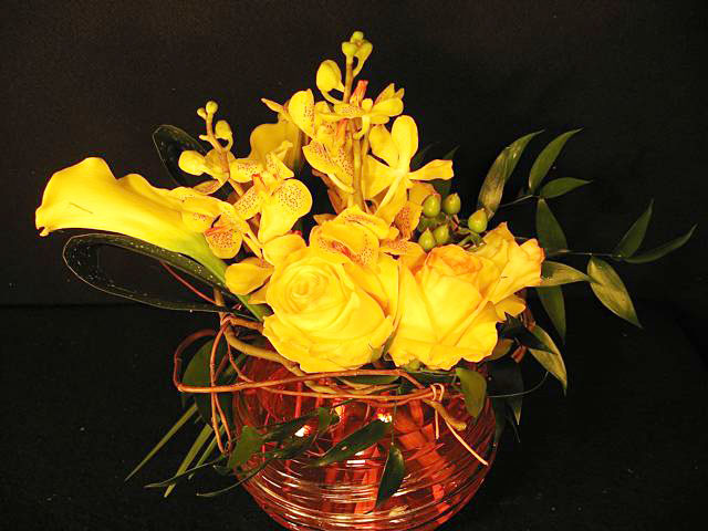 Centerpiece: roses, orchids, calla lily, curly willow