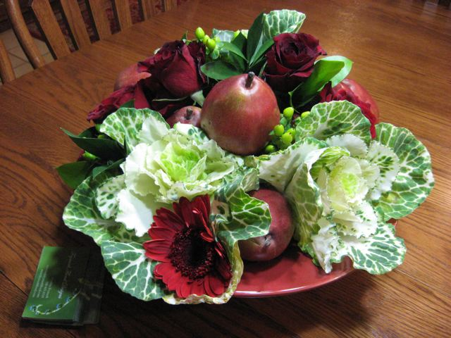 Kitchen table fresh floral design: pears, kale, Gerbera daisies, roses