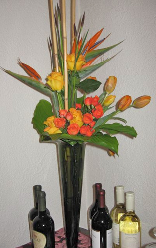 Buffet Design: birds of paradise, roses, tulips, hosta